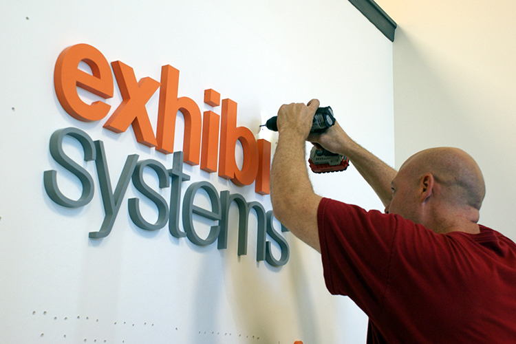 Exhibit Systems Wall Logo